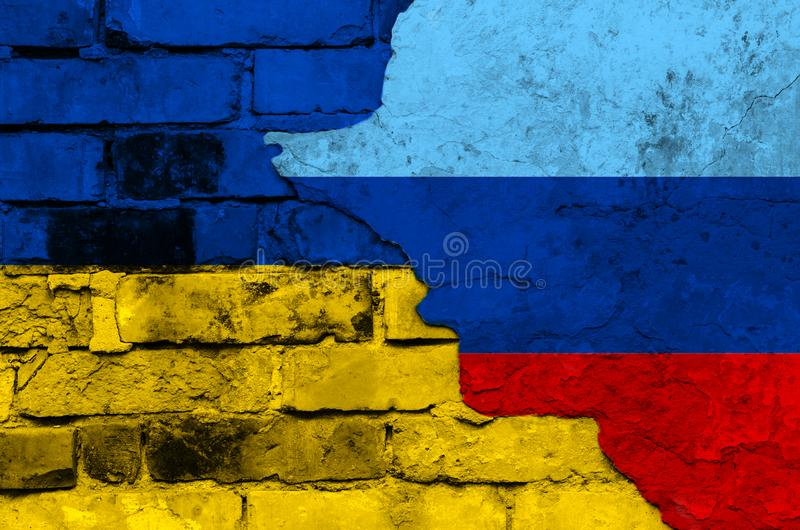 Flag of Ukraine and Lugansk People`s Republic on a textured brick wall. Horizontal frame stock photo