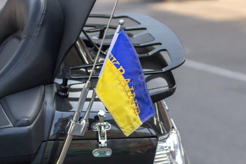 Flag of Ukraine on a motorcycle traveling biker. National symbol. Blue-yellow flag of Ukraine. Biker accessory. Patriotic sign on a motorcycle traveler royalty free stock photography