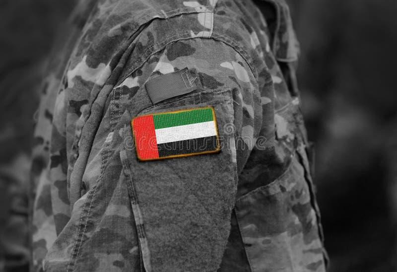 Flag of United Arab Emirates UAE on soldiers arm collage. Flag of United Arab Emirates UAE on soldiers arm. collage stock photo