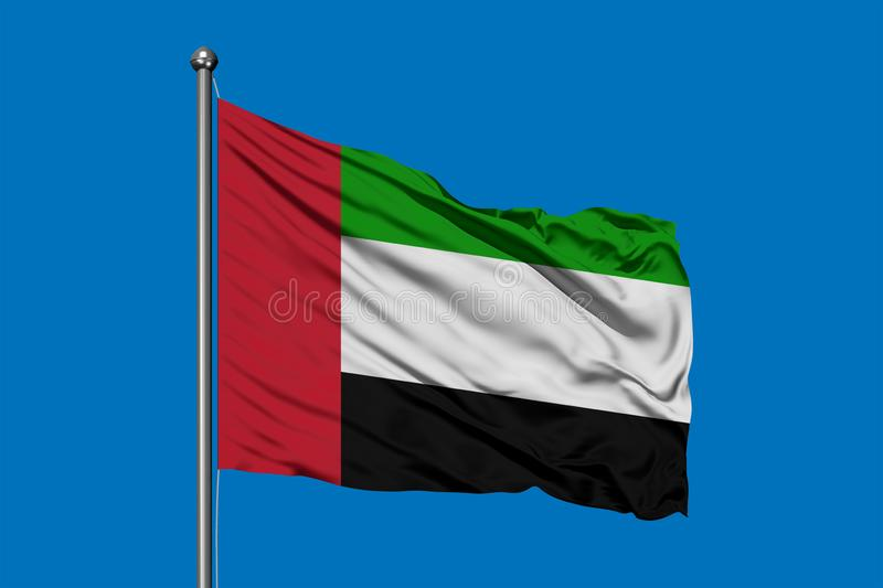 Flag of United Arab Emirates waving in the wind against deep blue sky. UAE flag.  stock images