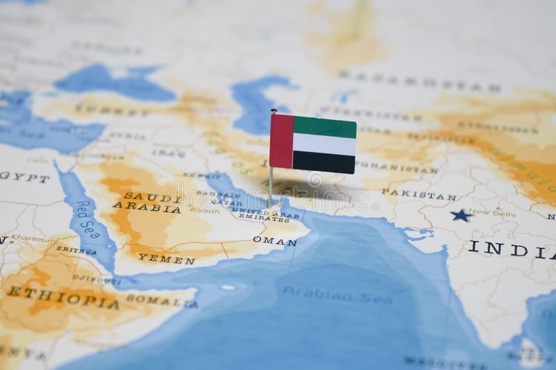 The Flag of united arab emirates in the world map royalty free stock photo