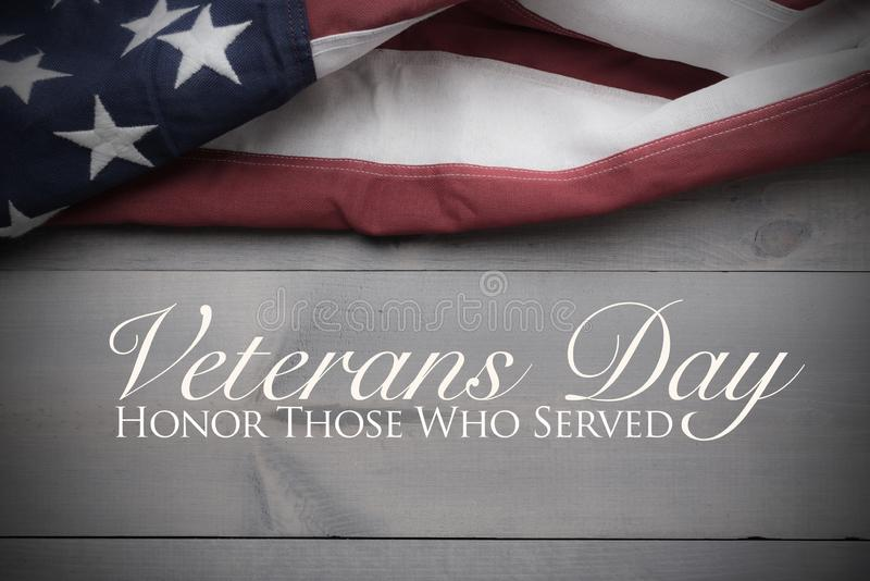 The flag of the United Sates on a grey plank background with copy space Veterans Day tribute. The flag of the United Sates of America on a grey plank background stock photos