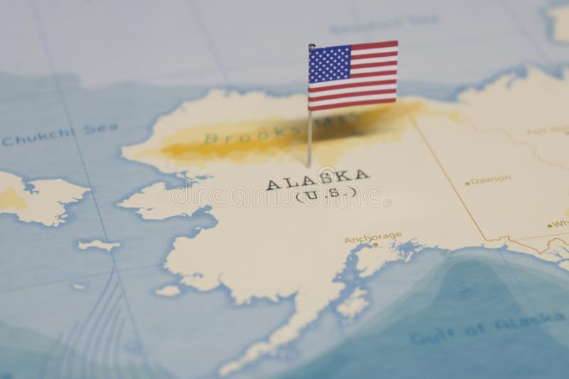 The Flag of the United States on the alaska in the world map royalty free stock image