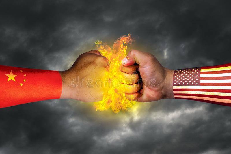 The flag of the United States of America and the flag of China and the economic struggle painted on the fist or hand mixed media stock photography