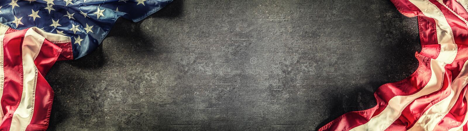 Flag of United States of America on a concrete background. Usa flags and stripes as a panoramic banner. American, patriotic, red, independence, white, blue royalty free stock photography