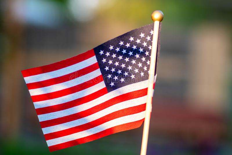 Flag of the United States. Green grass background. Celebration concept, Memorial Day, 4th of July , USA Independence Day.  stock photos