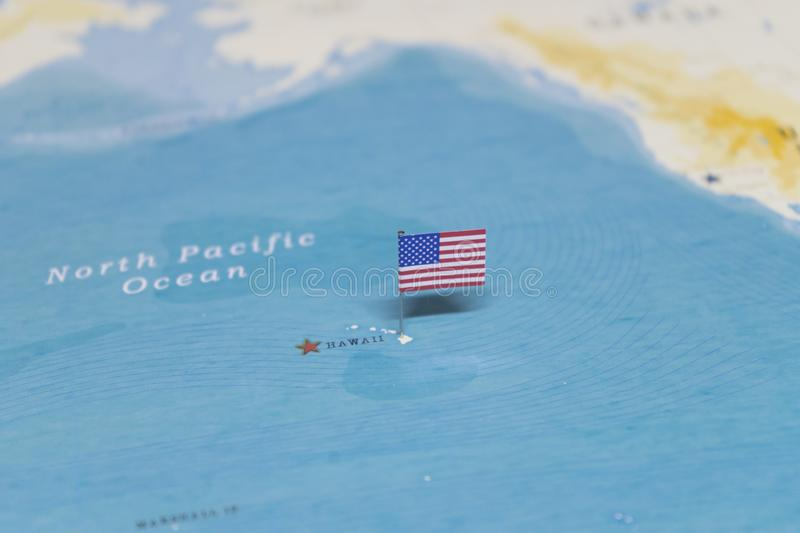 The Flag of the United States on the hawaii in the world map royalty free stock image