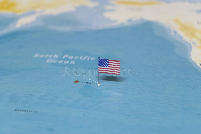 The Flag of the United States on the hawaii in the world map royalty free stock photography