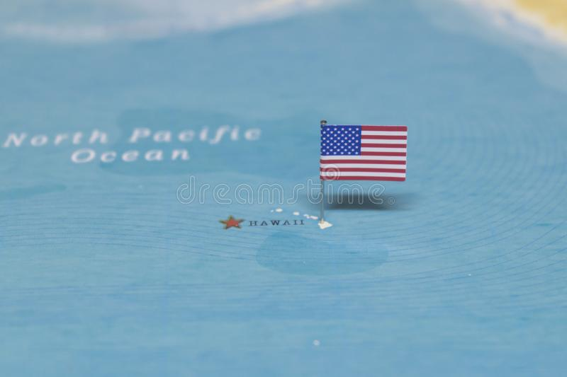 The Flag of the United States on the hawaii in the world map royalty free stock photo