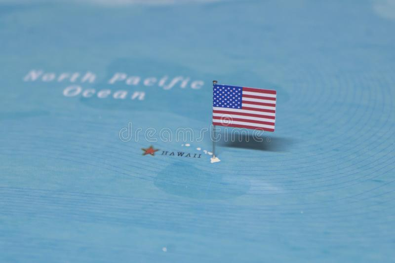 The Flag of the United States on the hawaii in the world map stock images