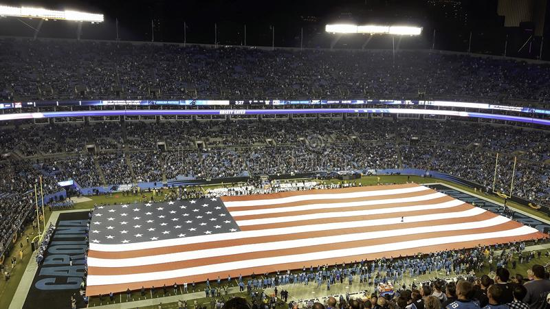 the flag of the united states in a stadium stock image
