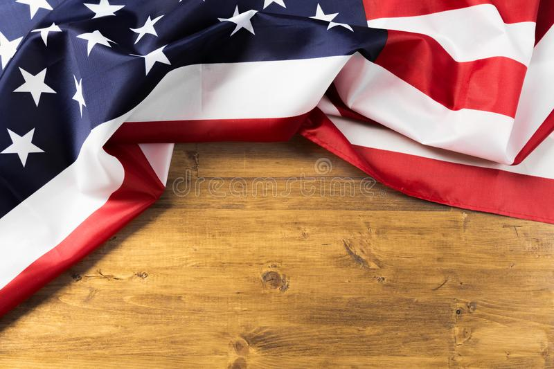 Flag of United States on a wooden table background royalty free stock photography