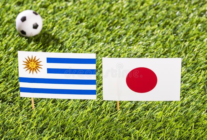 Flag of Uruguay and Japan in the football stadium - Copa América football tournament conmebol Brasil stock illustration
