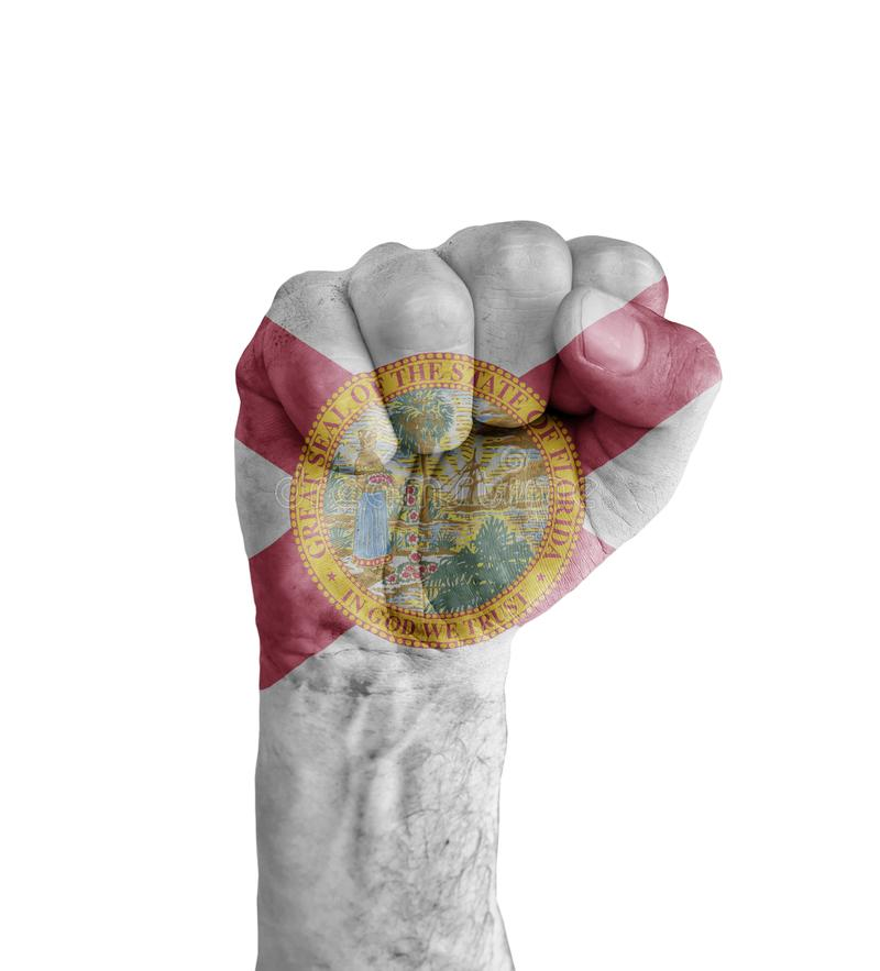 Flag of US Florida state painted on human fist like victory stock photography