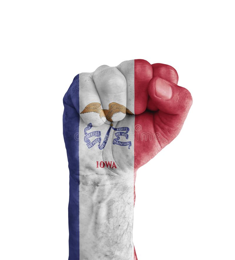 Flag of US Iowa state painted on human fist like victory symbol royalty free stock photography