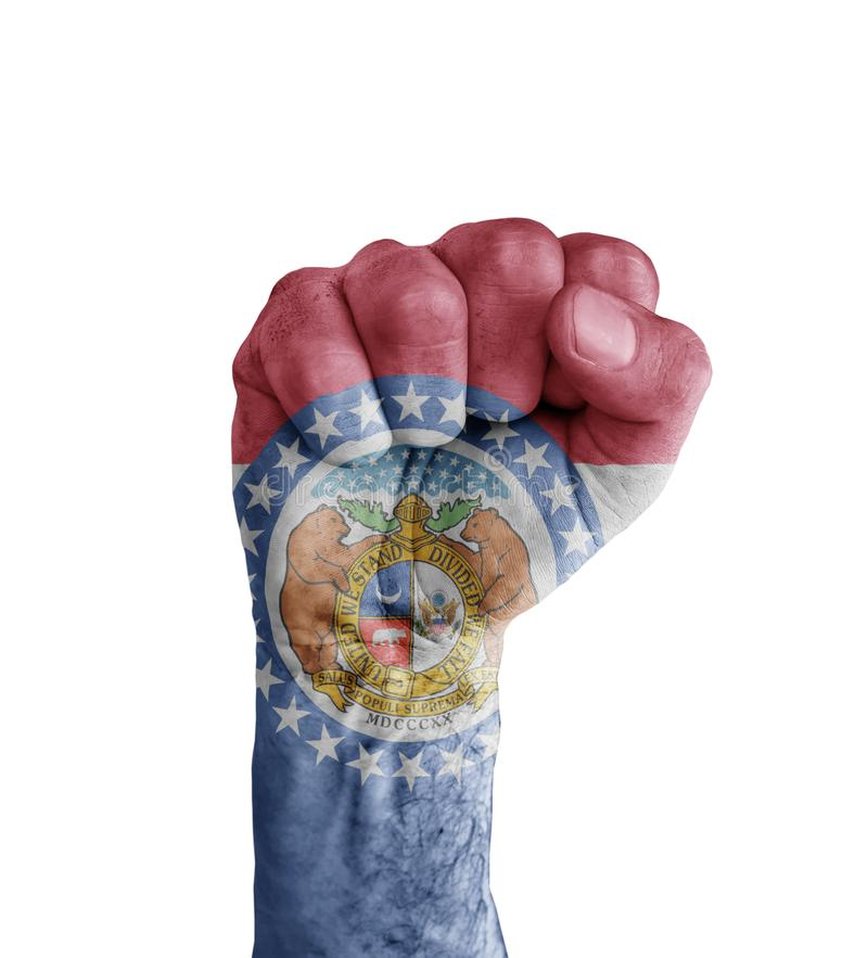 Flag of US Missouri state painted on human fist like victory stock photography