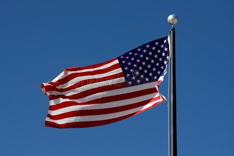 Flag of the USA. Waving in the wind royalty free stock photos