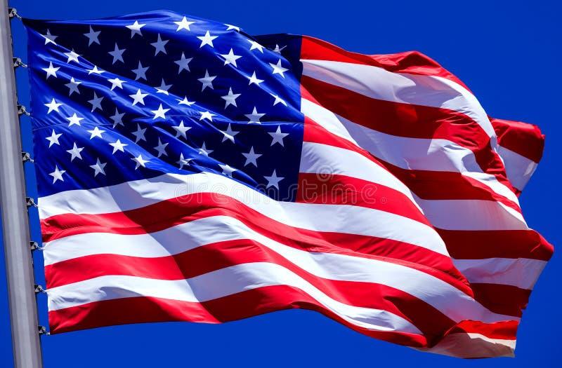 Flag of the USA. Against a blue sky stock photo