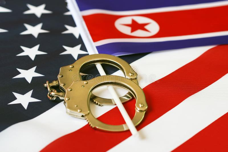 Flag of USA and North Korea. Handcuffs. Sanctions royalty free stock photo
