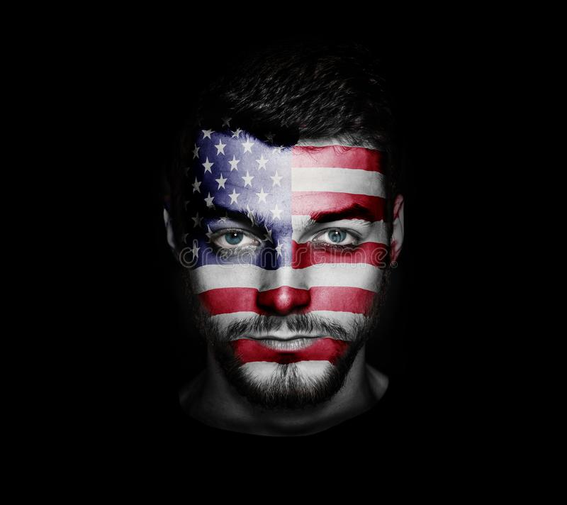 Flag of USA painted on a face of a man. royalty free stock photos