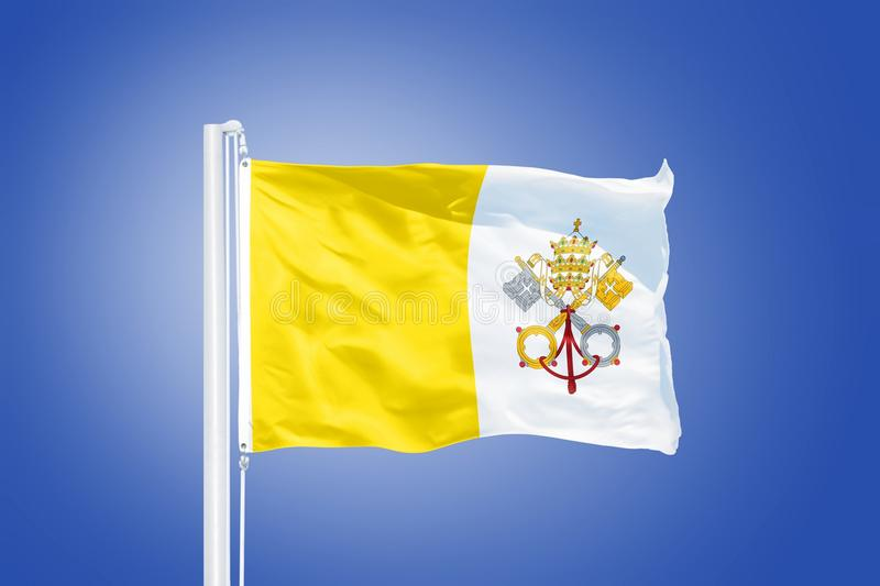 Flag of Vatican City flying against a blue sky.  stock images