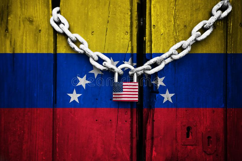 Flag of Venezuela painted on an old and cracked wooden door, which is closed by an old chain and a padlock that conceptually repre. Sents the sanctions or royalty free illustration