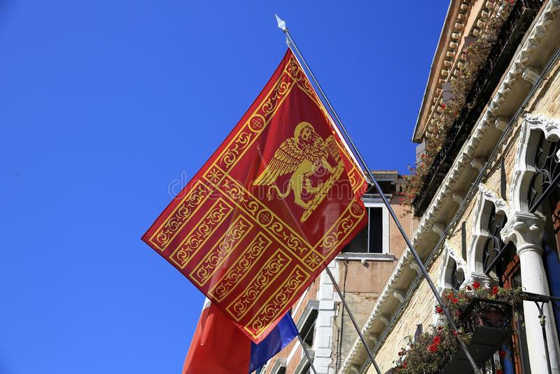Flag of Venice in venetian building stock image