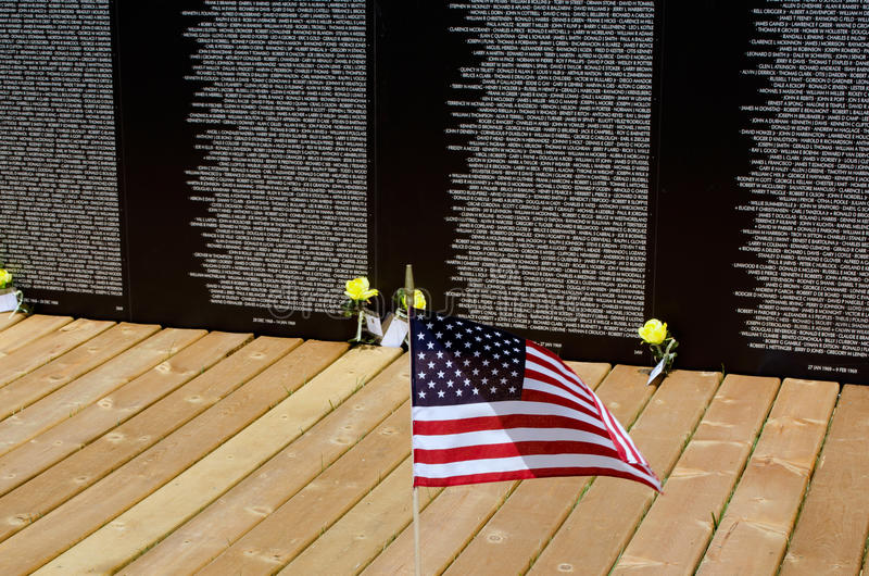Flag at the vietnam traveling wall memorial royalty free stock photography