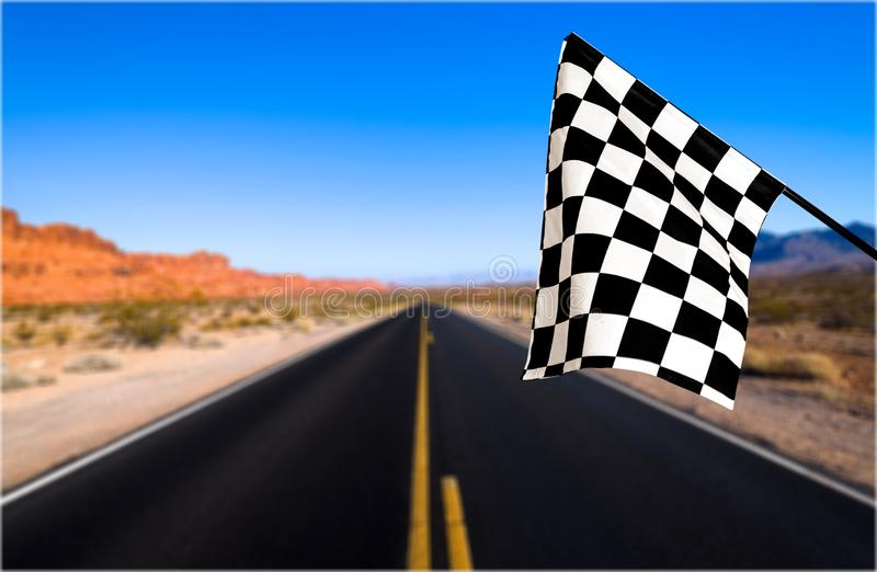 Checkered waving flag on background. Concept photo. Flag waving check checkered checker chequered flag car racing stock photo