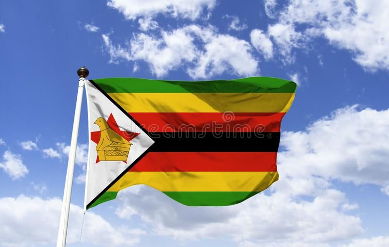 Flag of Zimbabwe, the bird soapstone. Flag of Zimbabwe, the soapstone bird is featured, found in the ruins of Greater Zimbabwe. The red star is a symbol of the royalty free stock photo