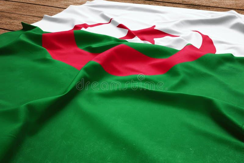 Flaga Algieria na drewnianym biurka tle Jedwabniczej algierczyk flagi odg?rny widok zdjęcie stock