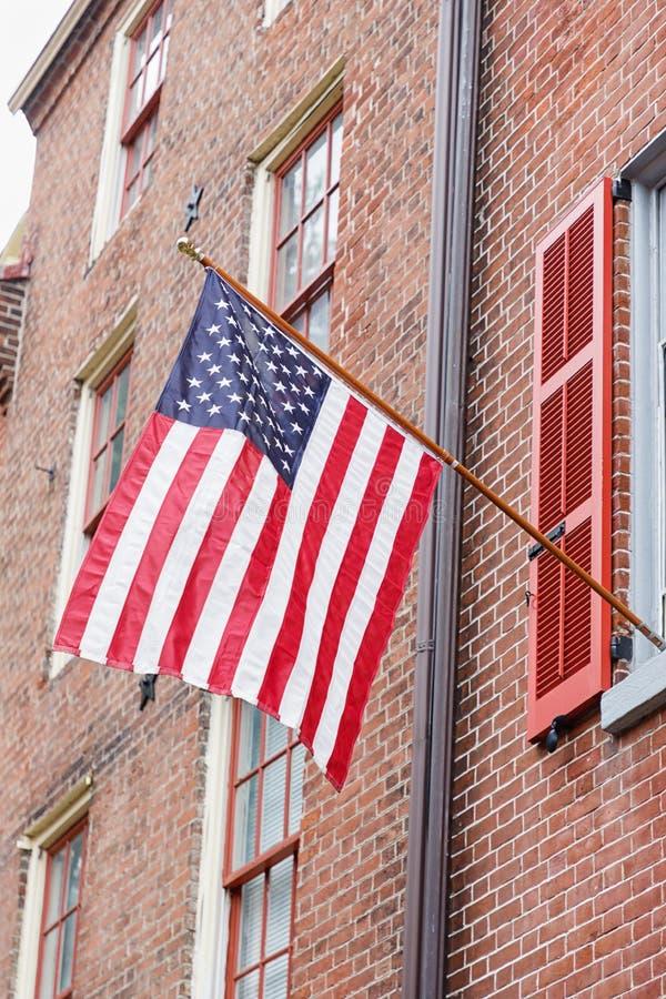 Flaga amerykańska na ściana z cegieł tle obraz royalty free