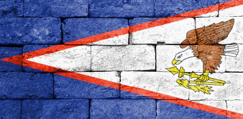Flaga amerykanin Samoa na starym ściana z cegieł zdjęcie stock