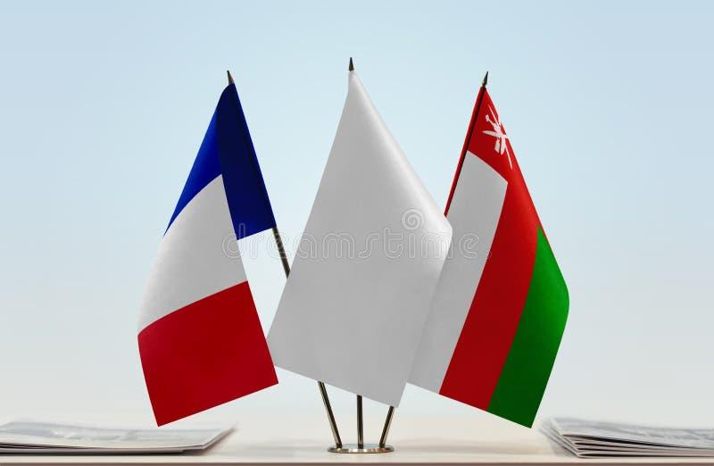 Flaga Francja i Oman zdjęcie royalty free