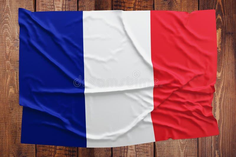 Flaga Francja na drewnianym sto?owym tle Marszcz?cy francuz flagi odg?rny widok obraz stock