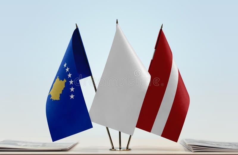 Flaga Kosowo i Latvia zdjęcie royalty free