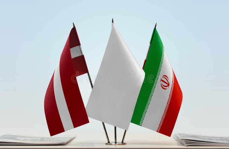 Flaga Latvia i Iran fotografia royalty free
