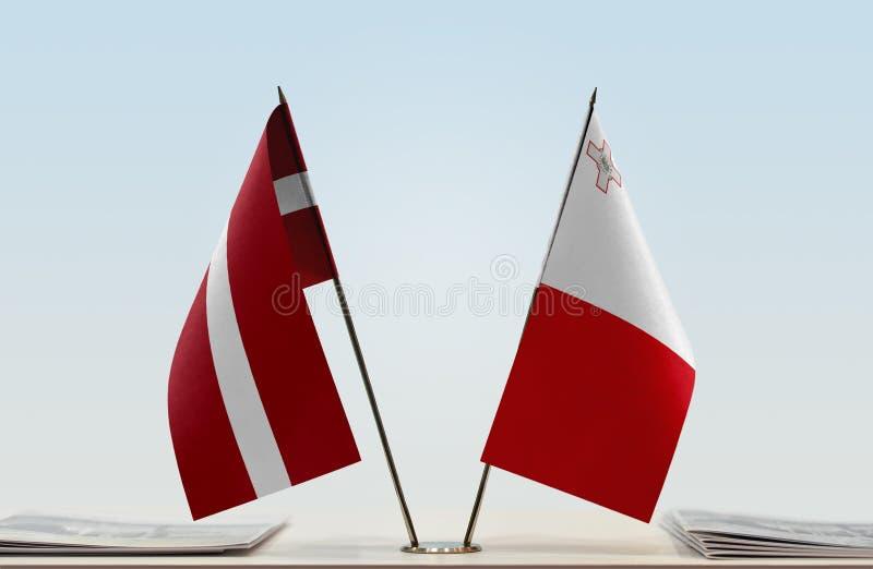 Flaga Latvia i Malta zdjęcie royalty free