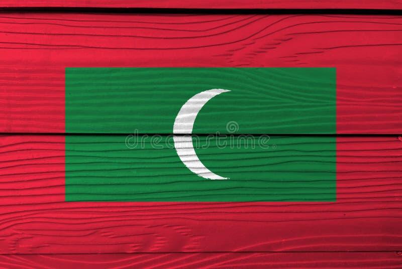 Flaga Maldives na drewnianym ściennym tle Grunge Maldives flaga tekstura zdjęcia stock