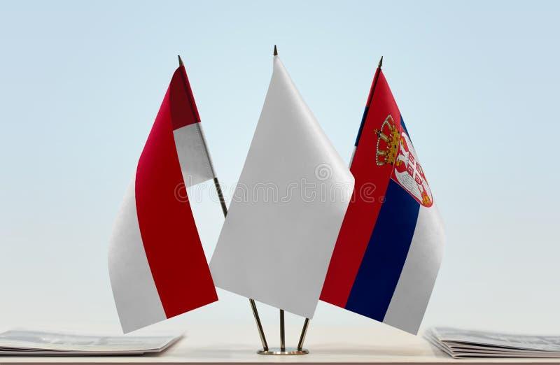 Flaga Monaco i Serbia zdjęcie royalty free