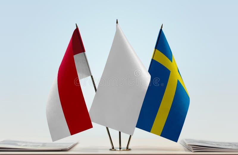 Flaga Monaco i Szwecja zdjęcia royalty free