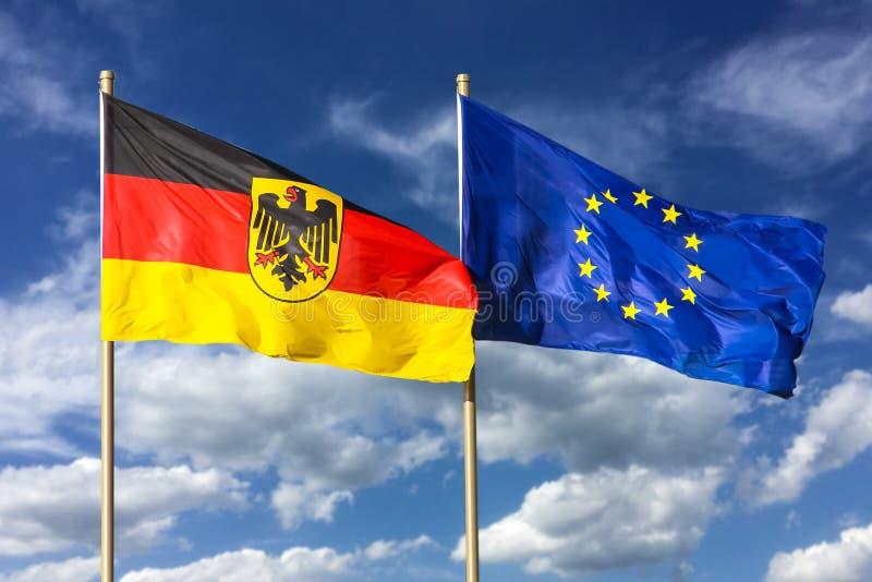 Flaga Niemcy Federacyjna republika Niemcy; w niemiec: Bundesrepublik Deutschland i Europejskiego zjednoczenia UE falowanie w wiat obrazy stock