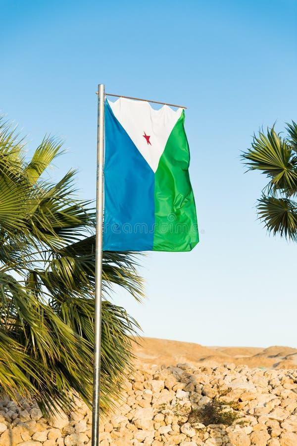 Flaga państowowa Djibouti na flagpole obrazy royalty free