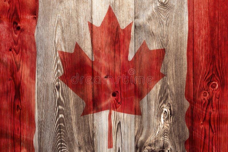 Flaga państowowa Kanada, drewniany tło fotografia stock
