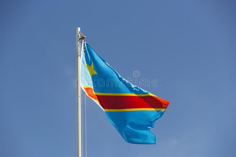 Flaga państowowa Kongo na flagpole zdjęcia royalty free