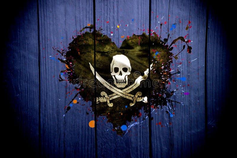 Flaga piraci w formie serca na ciemnym tle zdjęcia stock