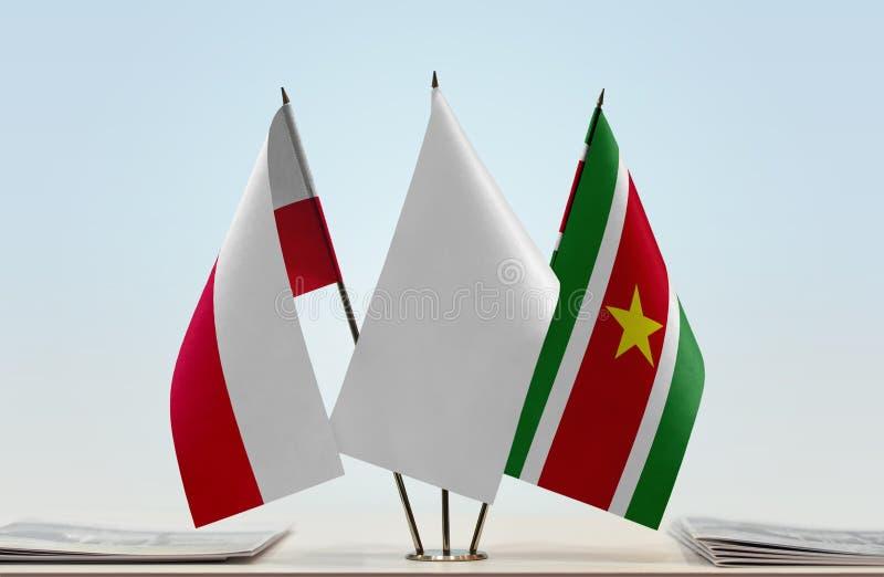 Flaga Polska i Suriname obrazy royalty free