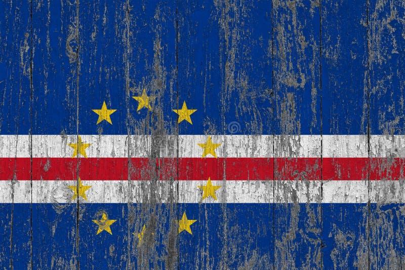 Flaga przylądek Verde malował na przetartym za drewnianym tekstury tle fotografia stock