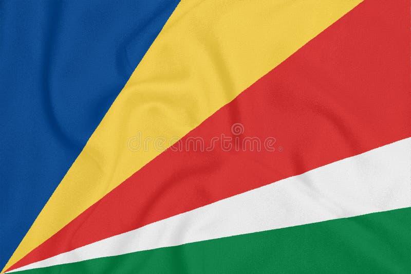 Flaga Seychelles na textured tkaninie patriotyczny symbol zdjęcie royalty free