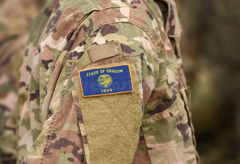 Flaga stanowa Oregonii w sprawie munduru wojskowego Stany Zjednoczone USA, armia, żołnierze Kolaż fotografia royalty free